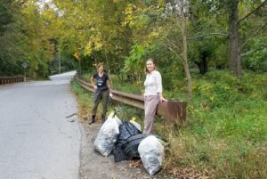 Volunteers with trash cleaned out of Roland Run in Towson.