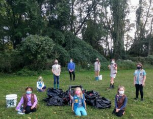 Girl Scouts clean trash out of stream